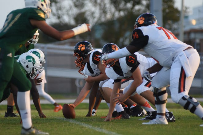The Cocoa Tigers offensive line gets ready to run a play against Viera on Friday.