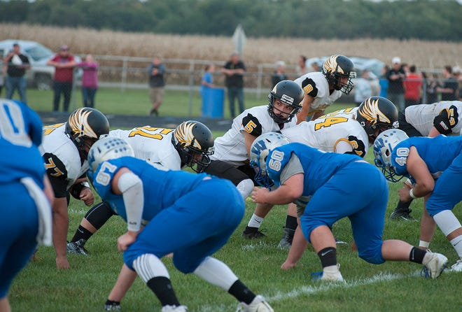 Zye Shipman and the Eagles line up at the line of scrimmage.