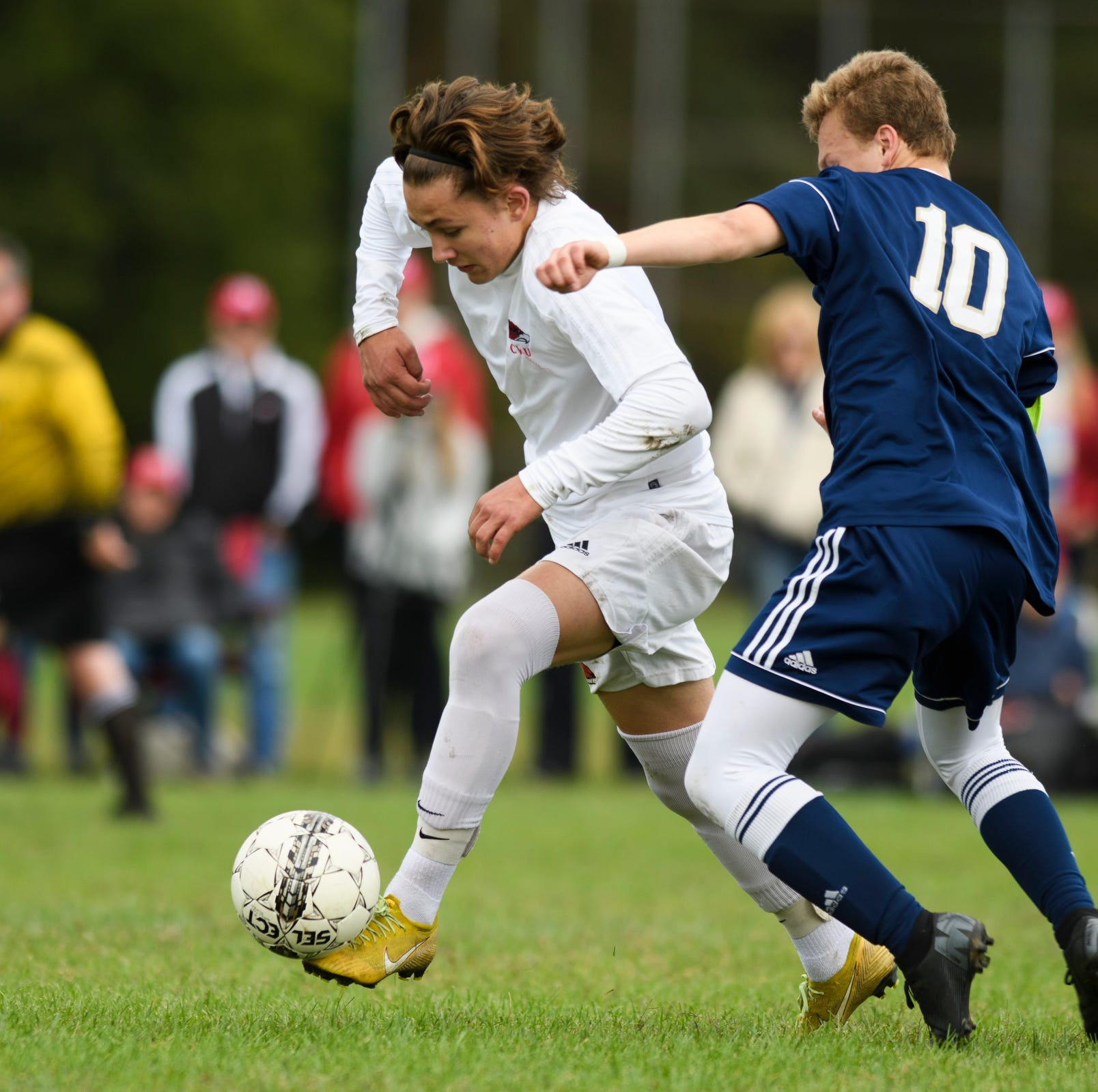 CVU's Caleb Martin (11) runs past Essex's Peter Osiecki (10) with the ball during the boys soccer game between the Champlain Valley Union Redhawks and the Essex Hornets at Essex High School on Saturday morning September 22, 2018 in Essex. (BRIAN JENKINS/for the FREE PRESS)