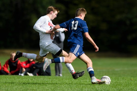 CVU's Chase Mitchell (24) battles for the ball with Essex's Joel Marquardt (13) during the boys soccer game between the Champlain Valley Union Redhawks and the Essex Hornets at Essex High School on Saturday morning September 22, 2018 in Essex. (BRIAN JENKINS/for the FREE PRESS)