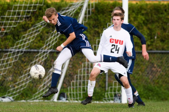 Essex's Peter Osiecki (10) heads the ball during the boys soccer game between the Champlain Valley Union Redhawks and the Essex Hornets at Essex High School last month.