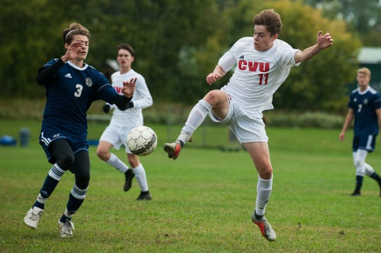 CVU's Caleb Martin (11) and Essex's Stefan Digangi (3) battle for the ball during the boys soccer game between the Champlain Valley Union Redhawks and the Essex Hornets at Essex High School on Saturday morning.