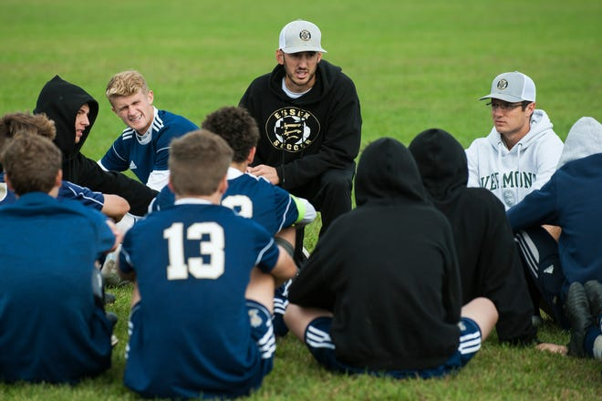 Essex head coach Jake Orr talks to the team during halftime during the boys soccer game between the Champlain Valley Union Redhawks and the Essex Hornets at Essex High School on Saturday morning September 22, 2018 in Essex. (BRIAN JENKINS/for the FREE PRESS)