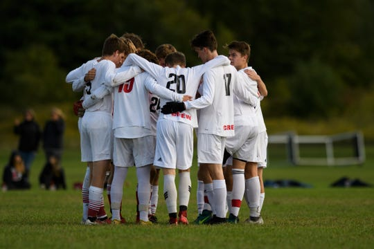 CVU huddles together during the boys soccer game between the Champlain Valley Union Redhawks and the Essex Hornets at Essex High School on Saturday morning September 22, 2018 in Essex. (BRIAN JENKINS/for the FREE PRESS)