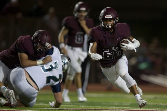 Flour Bluff's Isaac Miles rushes against Veterans Memorial during their game on Friday, Sep. 21, 2018, at Flour Bluff High School.