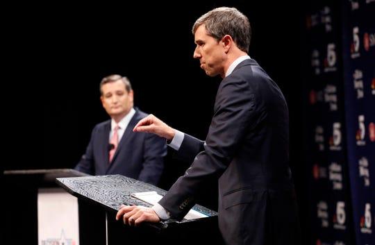 Republican U.S. Senator Ted Cruz, left, and Democratic U.S. Representative Beto O'Rourke, right, take part in their first debate for the Texas U.S. Senate in Dallas, Friday, Sept. 21, 2018. (Tom Fox/The Dallas Morning News via AP, Pool)