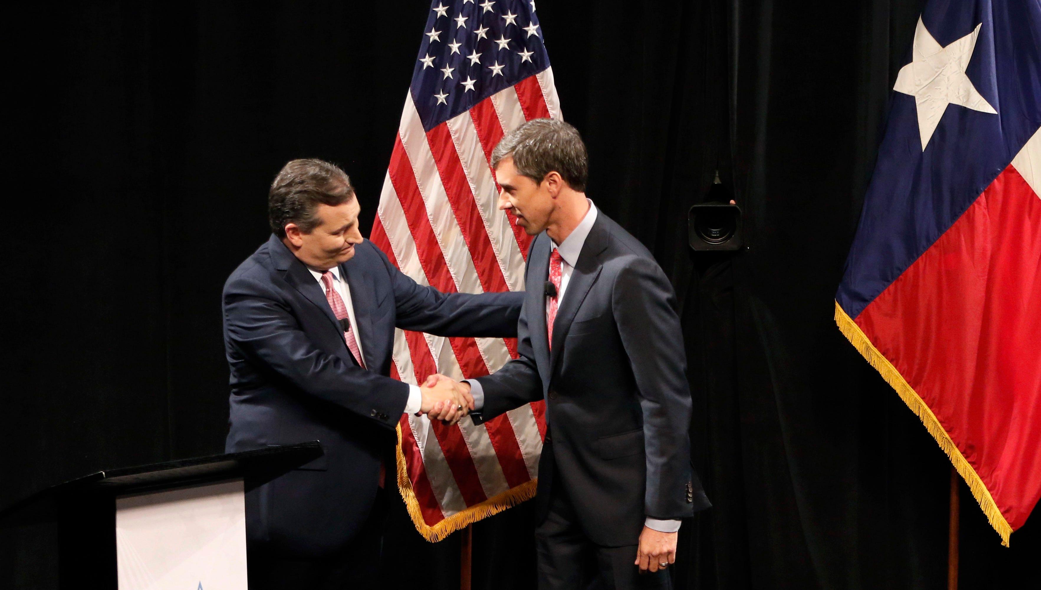 Republican U.S. Senator Ted Cruz, left, and Democratic U.S. Representative Beto O'Rourke, right, shake hands following their first debate for the Texas U.S. Senate in Dallas, Friday, Sept. 21, 2018. (Nathan Hunsinger/The Dallas Morning News via AP, Pool)