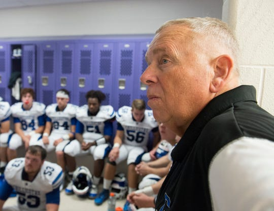 Chillicothe's head coach Ron Hinton looks on as coaches go over plays with Cavaliers during a lightning delay at Logan High School on Friday, Sept. 21, 2018. The Cavaliers defeated the Logan High Chieftains 7-6.