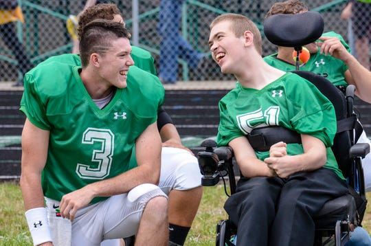 Elijah McCloskey talks with fellow senior David Chaffin during their homecoming game against Paint Valley on September 21, 2018. McCloskey credits his friends and family and the entire Huntington community for his successes.