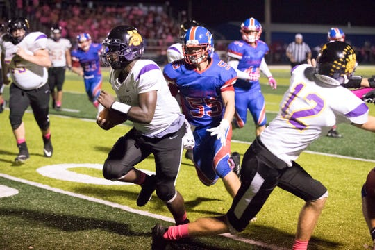 Unioto's Jamarcus Carroll powers through Zane traces defense to help score for Unioto Friday night at Zane Trace High School. Zane Trace held its annual Pink Play for a Cure game on September 21, 2018, at Zane Trace High School to help bring awareness to cancer with all proceeds going to Adena Cancer Center. Unioto went on to defeat Zane Trace 21-0.