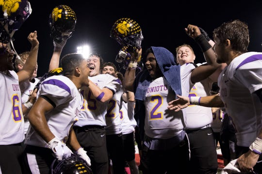 Unioto's Jamarcus Carroll (2) celebrates with teammates on Sept. 21, 2018 after the Shermans defeated Zane Trace 21-0 at Zane Trace High School. The team is looking to improve on last year's 5-2 record.