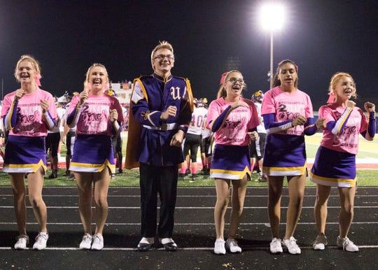 Unioto High School's cheerleaders and band members dance together while wearing pink to help support cancer research at Zane Trace High School's annual Pink Play for a Cure game.