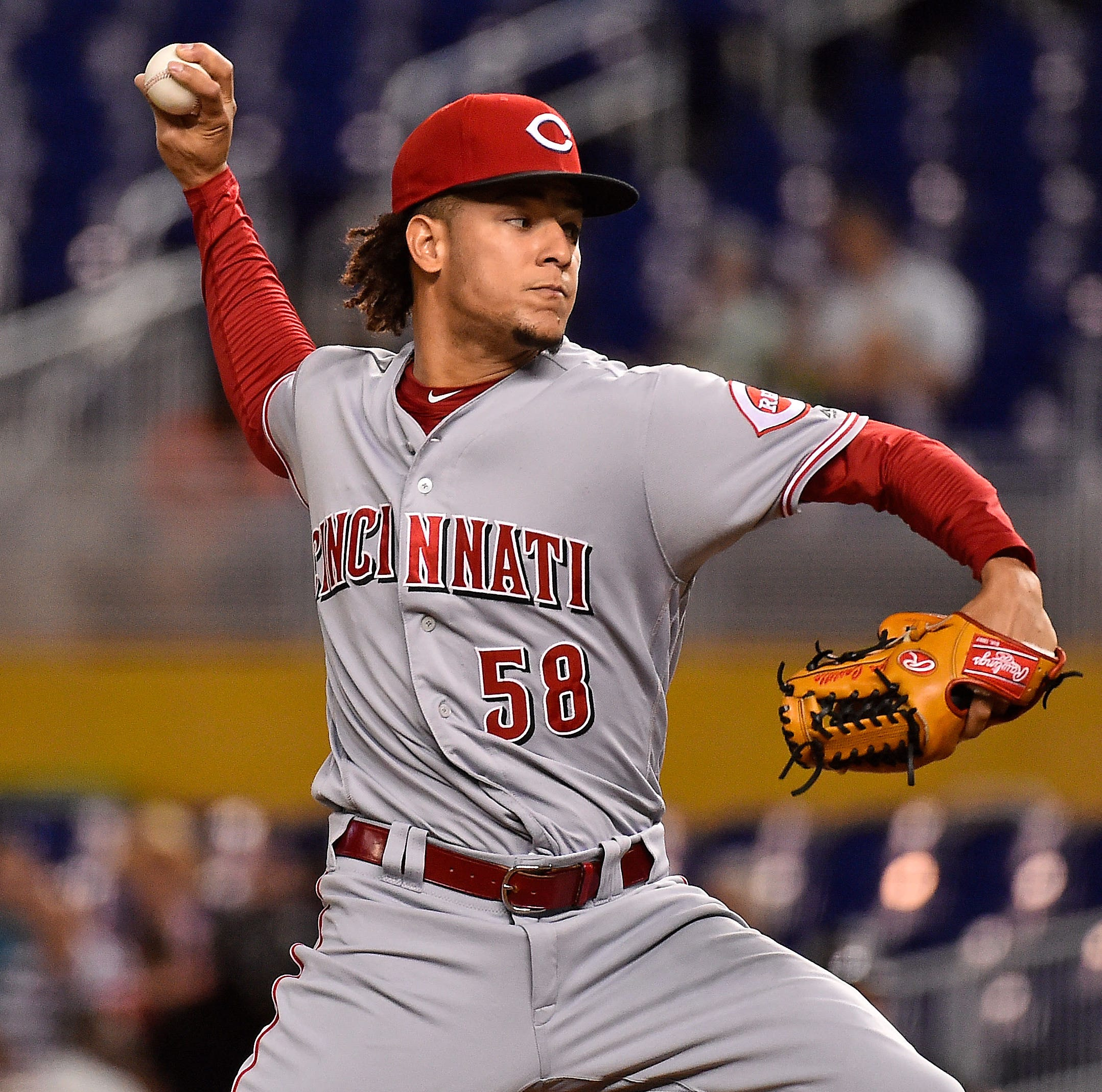 Castillo pitches longest start of career, Cincinnati Reds lose in extras to Miami Marlins