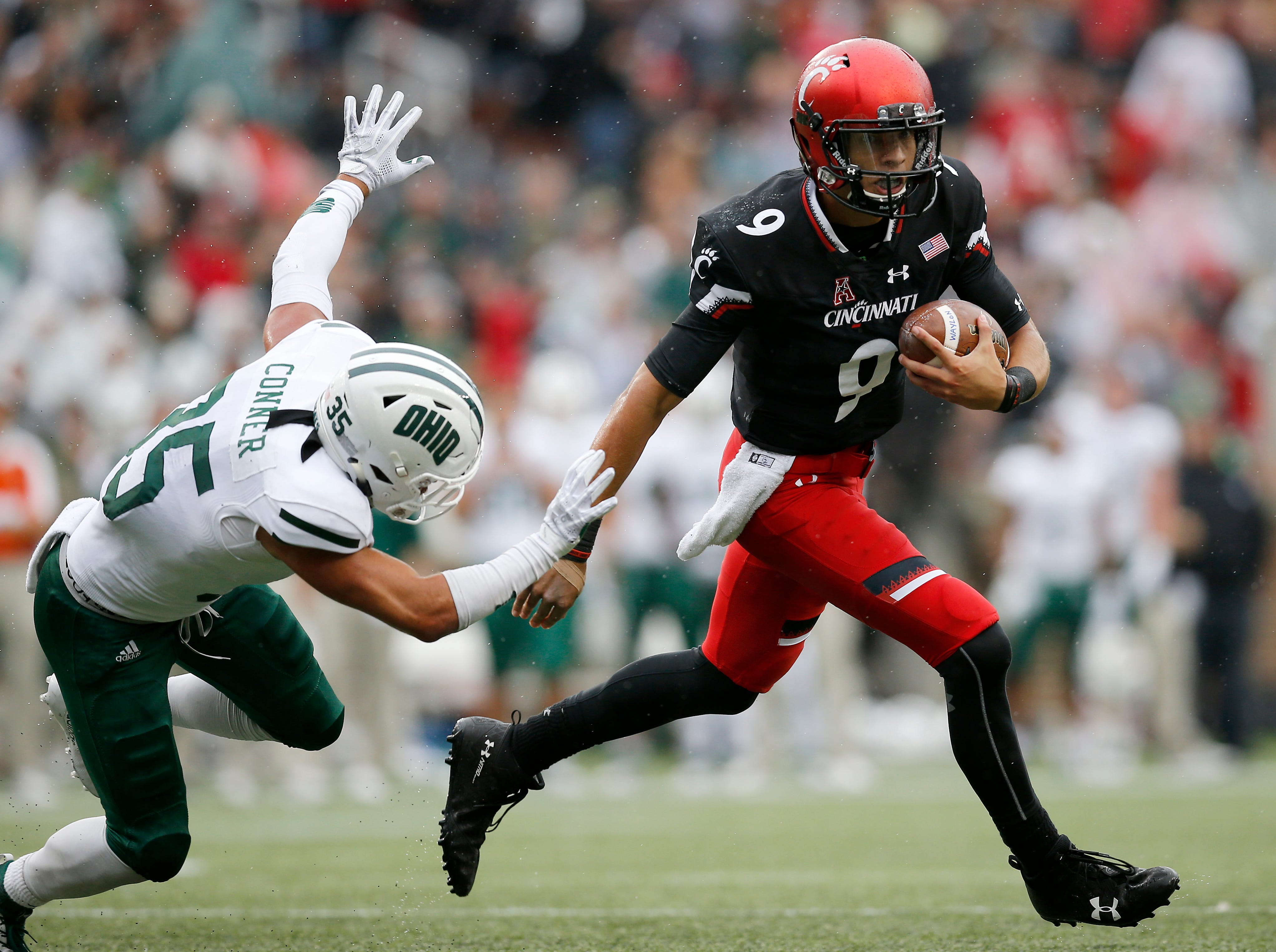 Cincinnati Bearcats quarterback Desmond Ridder (9) breaks away on a touchdown run in the third quarter of the NCAA football game between the Cincinnati Bearcats and the Ohio Bobcats at Nippert Stadium on the University of Cincinnati campus in Cincinnati on Saturday, Sept. 22, 2018. The Bearcats overcame a 24-7 deficit at halftime to win 34-30, improving to 4-0 on the season.