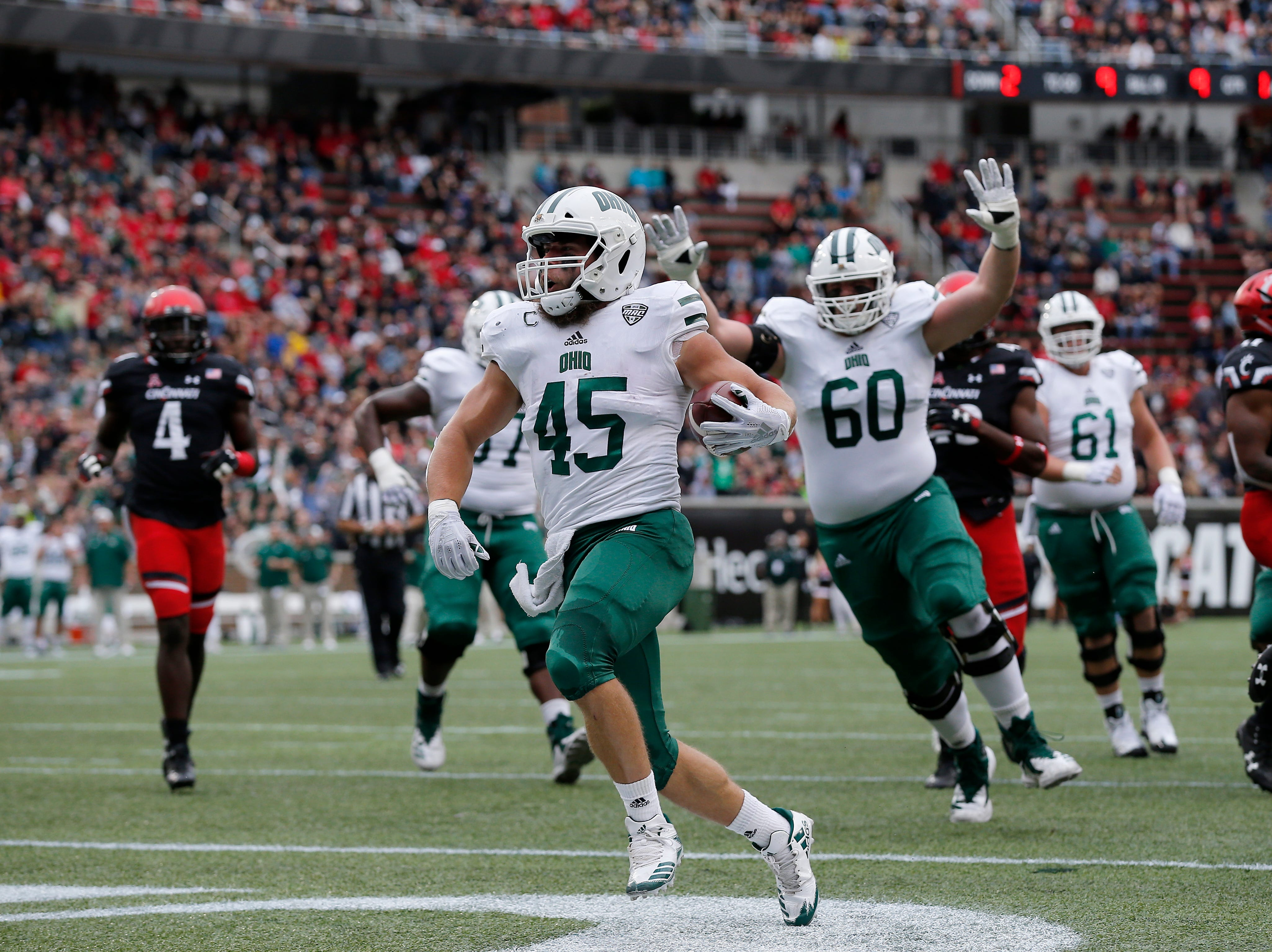 Ohio Bobcats running back A.J. Ouellette (45) runs in a carry for a touchdown in the first quarter of the NCAA football game between the Cincinnati Bearcats and the Ohio Bobcats at Nippert Stadium on the University of Cincinnati campus in Cincinnati on Saturday, Sept. 22, 2018. The Bobcats led 24-7 at halftime.