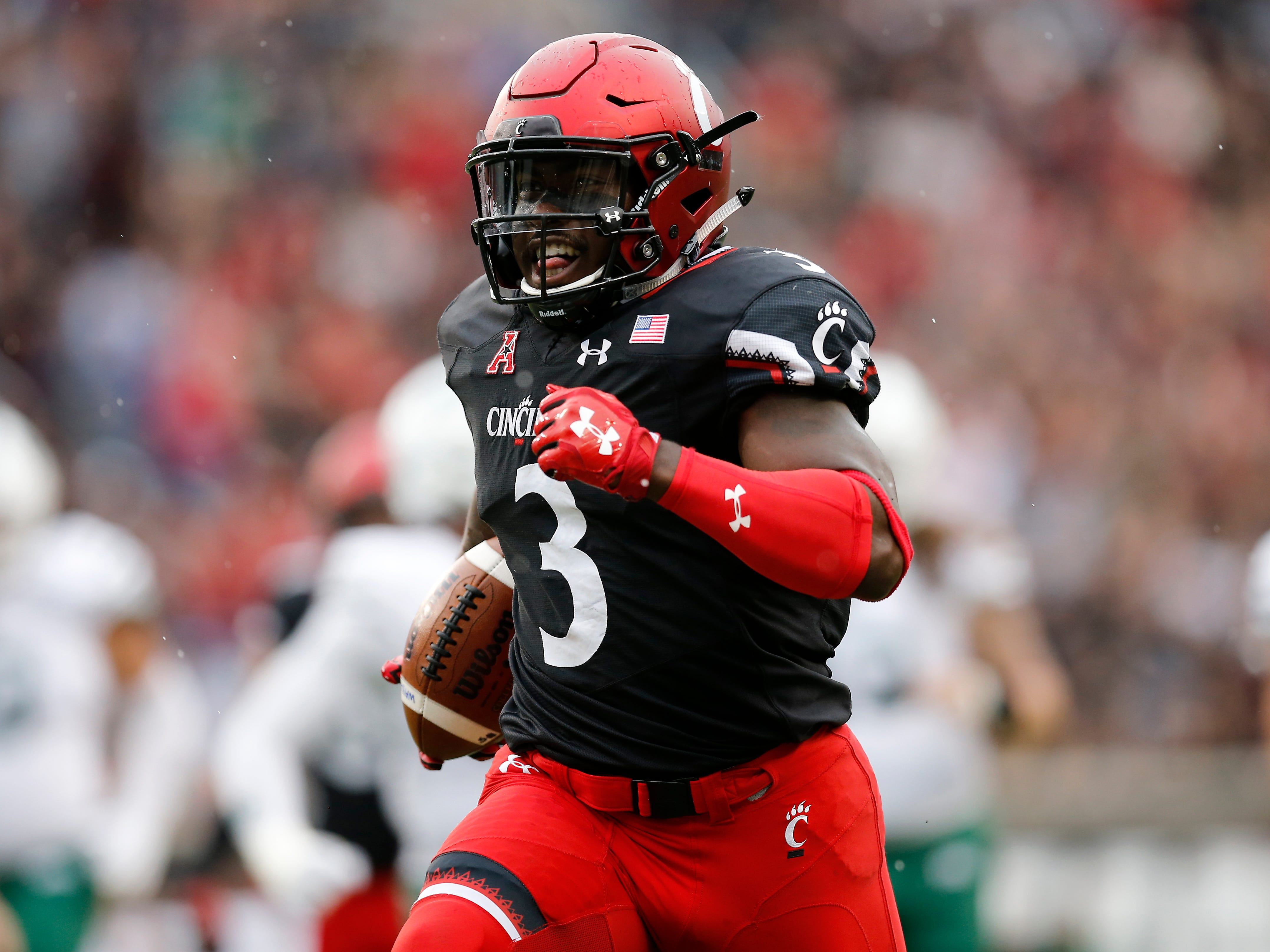 Cincinnati Bearcats running back Michael Warren II (3) runs the ball in for a touchdown in the second quarter of the NCAA football game between the Cincinnati Bearcats and the Ohio Bobcats at Nippert Stadium on the University of Cincinnati campus in Cincinnati on Saturday, Sept. 22, 2018. The Bobcats led 24-7 at halftime.