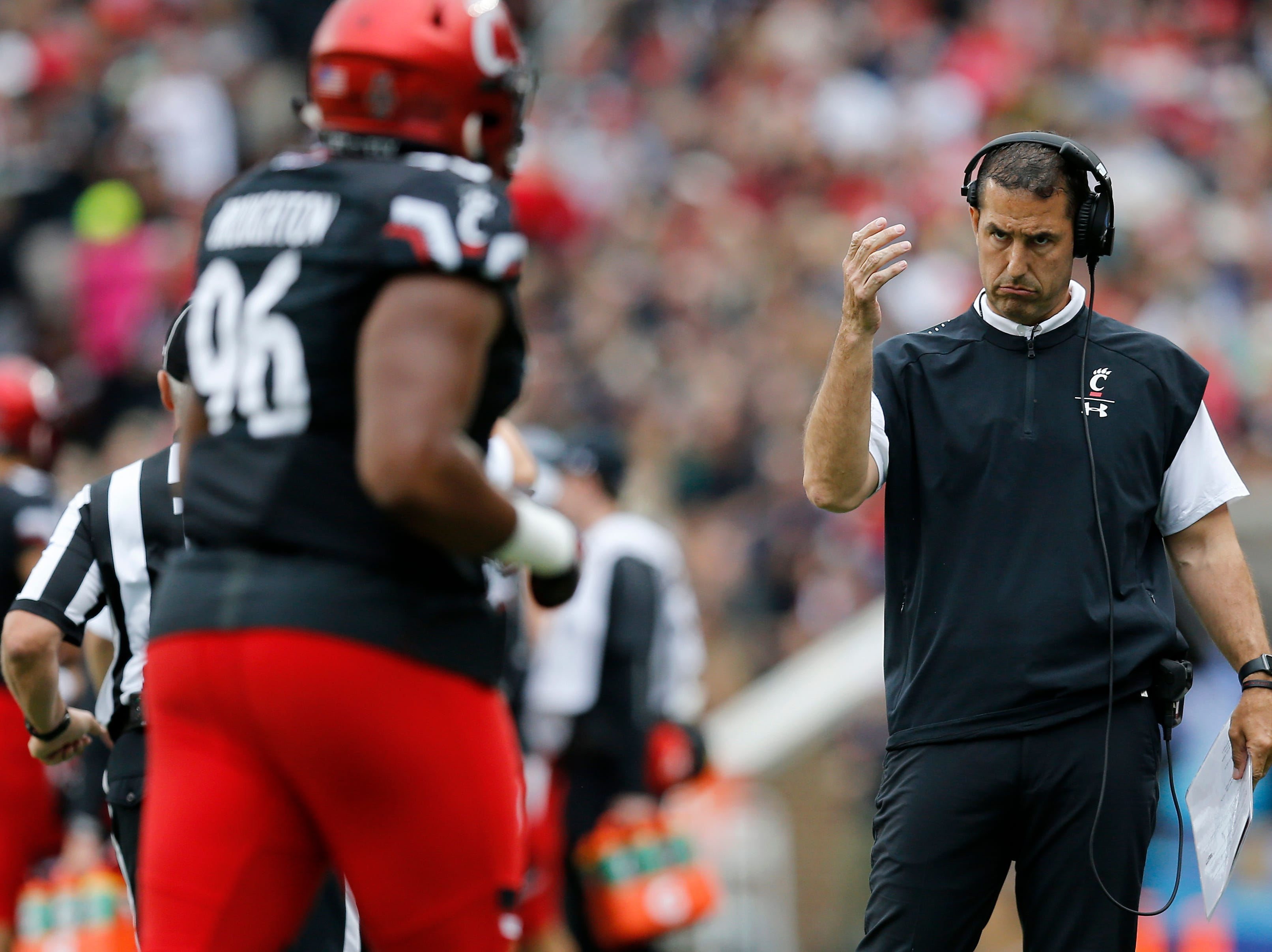 Cincinnati Bearcats head coach Luke Fickell pulls his defense off the field after giving up a touchdown in the first quarter of the NCAA football game between the Cincinnati Bearcats and the Ohio Bobcats at Nippert Stadium on the University of Cincinnati campus in Cincinnati on Saturday, Sept. 22, 2018. The Bobcats led 24-7 at halftime.