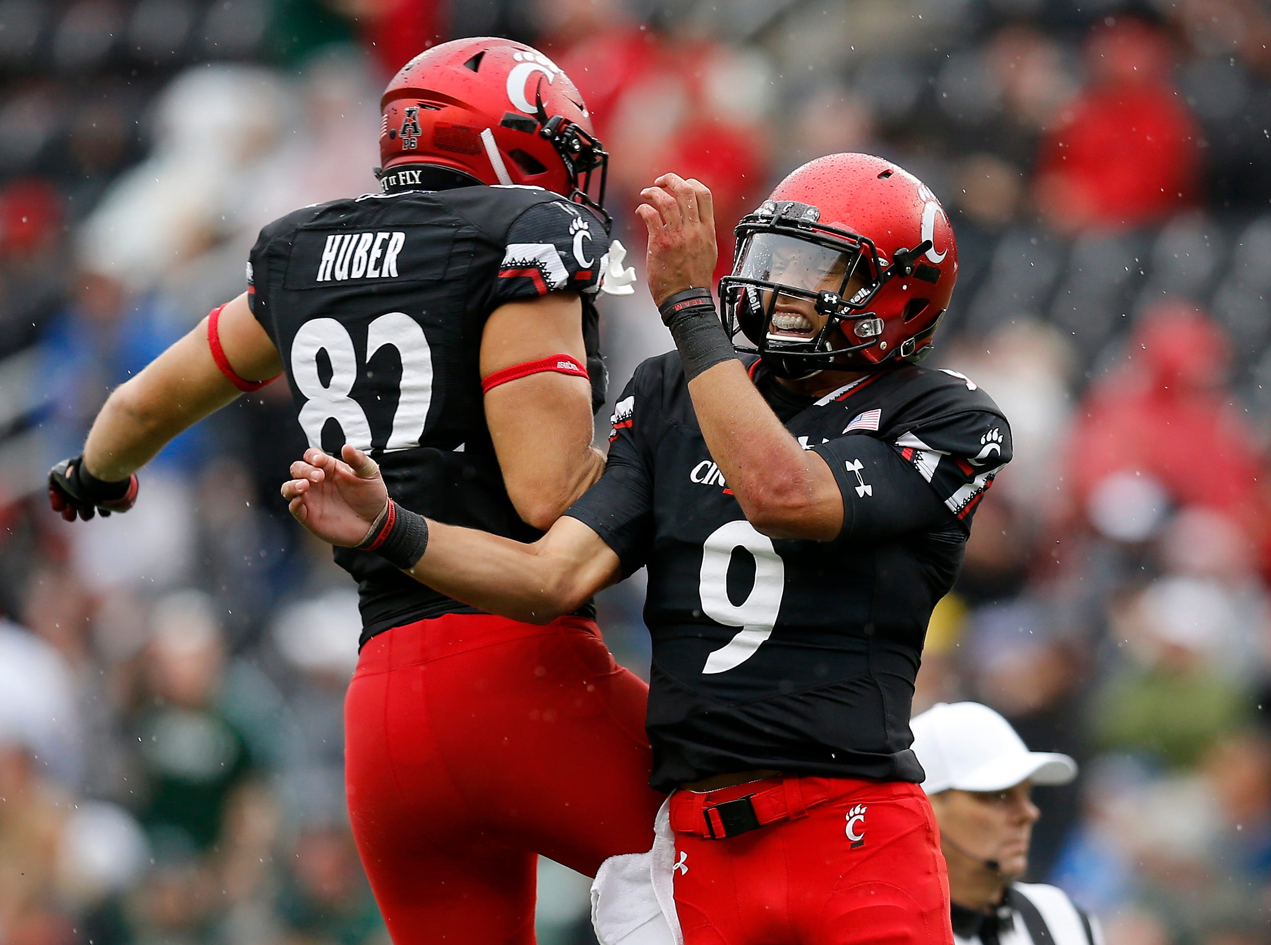 Cincinnati Bearcats tight end Wilson Huber (82) and  quarterback Desmond Ridder (9) celebrate after a touchdown in the fourth quarter of the NCAA football game between the Cincinnati Bearcats and the Ohio Bobcats at Nippert Stadium on the University of Cincinnati campus in Cincinnati on Saturday, Sept. 22, 2018. The Bearcats overcame a 24-7 deficit at halftime to win 34-30, improving to 4-0 on the season.
