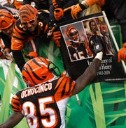 Cincinnati Bengals wide receiver Chad Ochocinco (85) runs to a sign in memory of Chris Henry after scoring a touchdown against the Kansas City Chiefs in 2009.