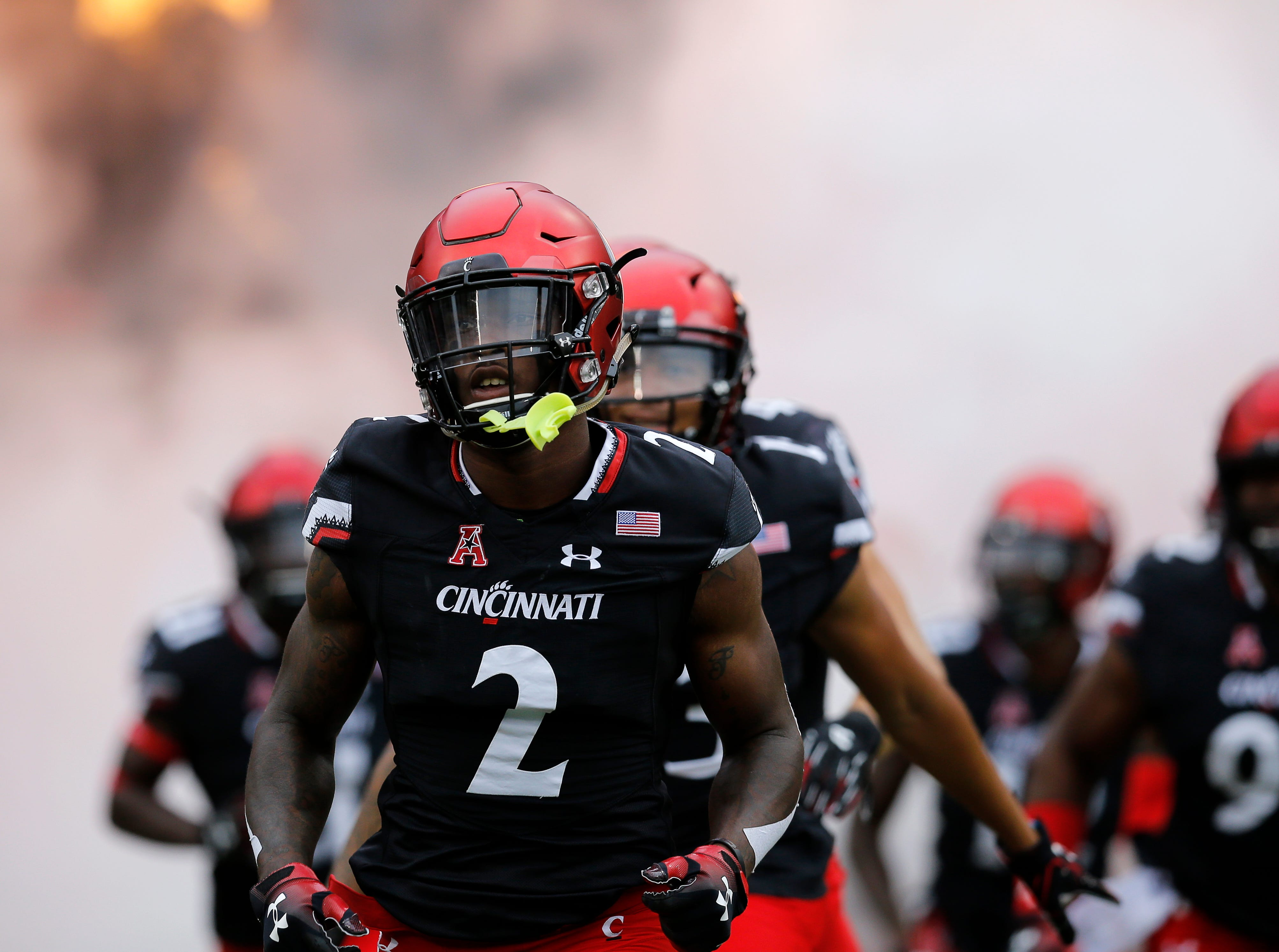 Cincinnati Bearcats cornerback Tyrell Gilbert (2) and the Bearcats take the field before the first quarter of the NCAA football game between the Cincinnati Bearcats and the Ohio Bobcats at Nippert Stadium on the University of Cincinnati campus in Cincinnati on Saturday, Sept. 22, 2018. The Bobcats led 24-7 at halftime.
