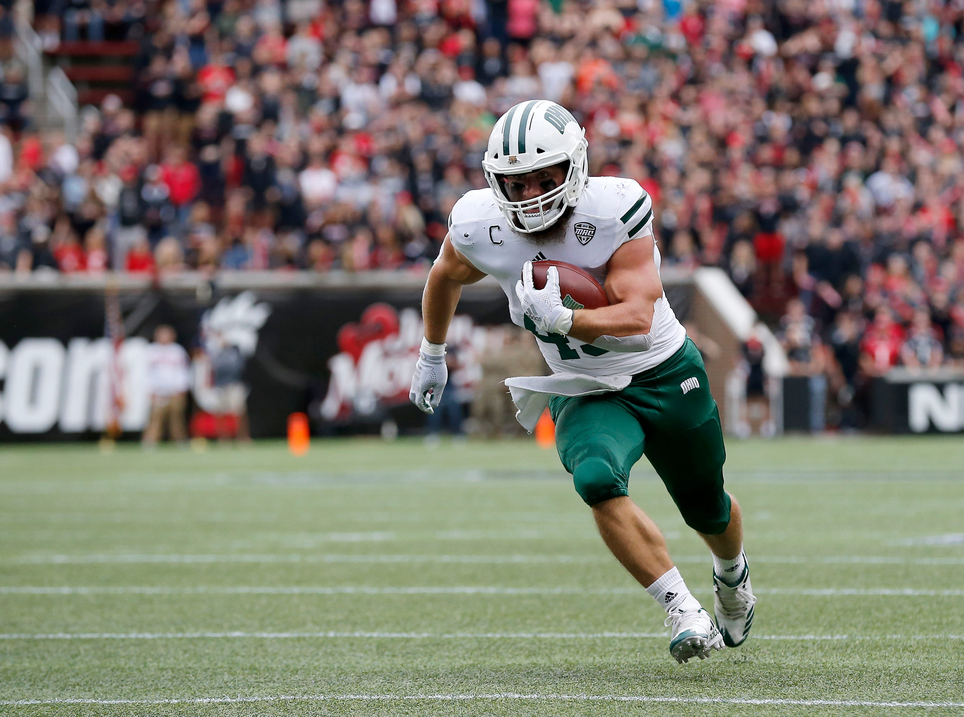 Ohio Bobcats quarterback Nathan Rourke (12) runs the ball on a QB keeper in the first quarter of the NCAA football game between the Cincinnati Bearcats and the Ohio Bobcats at Nippert Stadium on the University of Cincinnati campus in Cincinnati on Saturday, Sept. 22, 2018. The Bobcats led 24-7 at halftime.