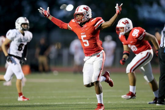 Lakota West Firebirds defensive back JJ Ross (5) celebrates a fumble recovery in the second quarter during a high school football game between the Oak Hills Highlanders and Lakota West Firebirds, Friday, Sept. 21, 2018, at Lakota West High School in West Chester Township, Ohio.