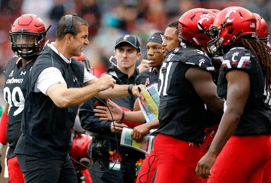 Cincinnati Bearcats head coach Luke Fickell pushes back his team after a penalty in the third quarter of the NCAA football game between the Cincinnati Bearcats and the Ohio Bobcats at Nippert Stadium on the University of Cincinnati campus in Cincinnati on Saturday, Sept. 22, 2018. The Bearcats overcame a 24-7 deficit at halftime to win 34-30, improving to 4-0 on the season.