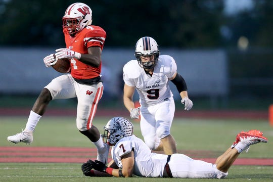 Lakota West Firebirds running back David Afari (4) avoids a tackle by Oak Hills Highlanders linebacker James Patrick (7) in the second quarter during a high school football game between the Oak Hills Highlanders and Lakota West Firebirds, Friday, Sept. 21, 2018, at Lakota West High School in West Chester Township, Ohio.