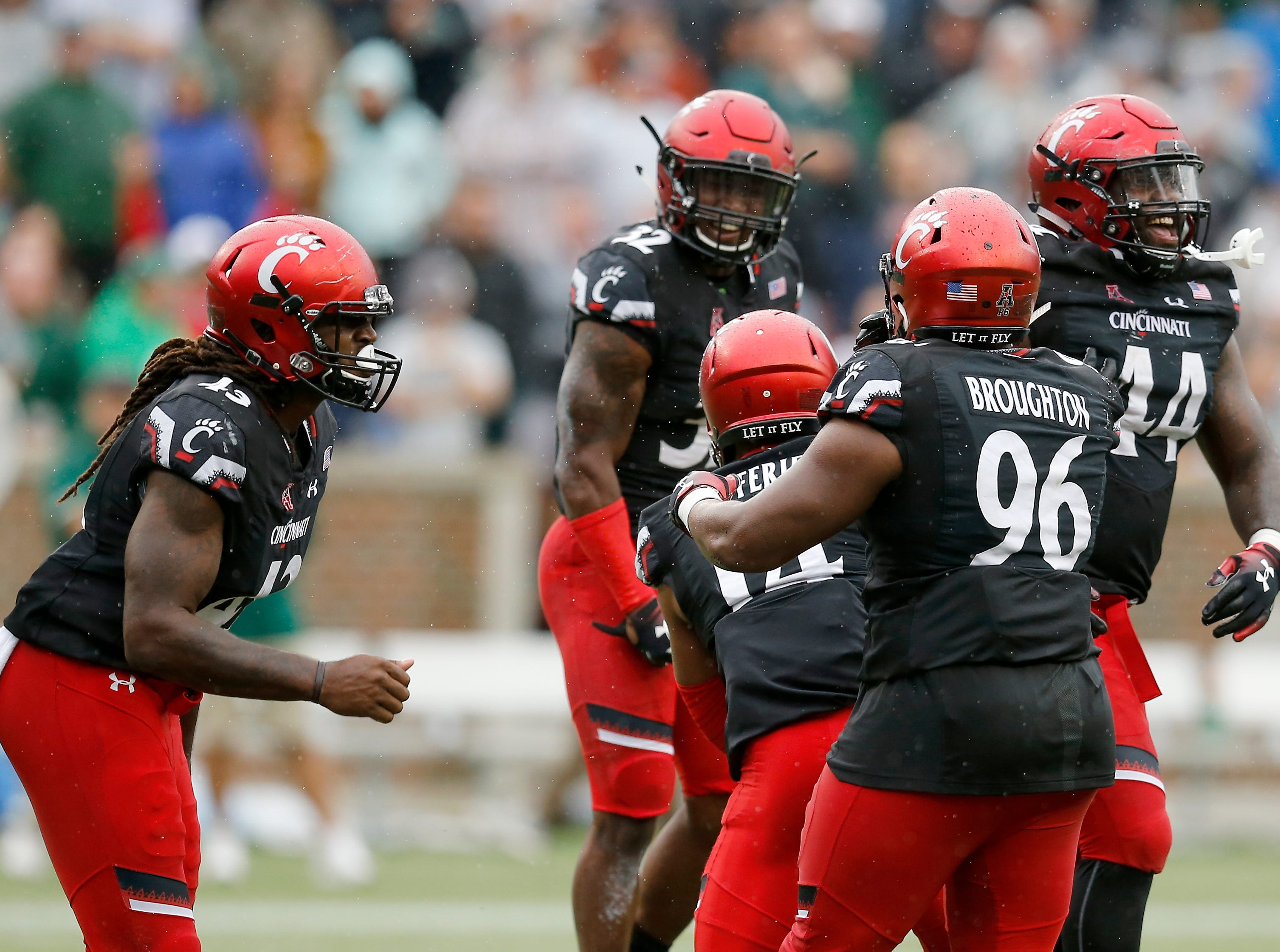 The Bearcats defense celebrates a successful goal line stands to keep the lead in the final minute of the fourth quarter of the NCAA football game between the Cincinnati Bearcats and the Ohio Bobcats at Nippert Stadium on the University of Cincinnati campus in Cincinnati on Saturday, Sept. 22, 2018. The Bearcats overcame a 24-7 deficit at halftime to win 34-30, improving to 4-0 on the season.
