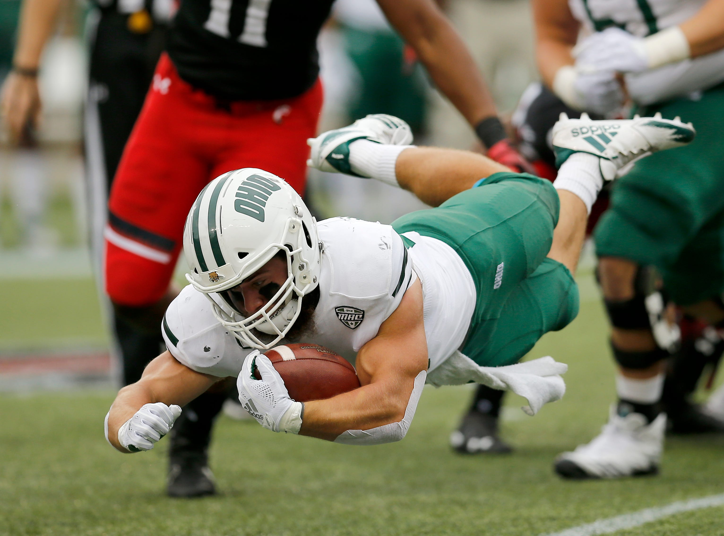 Ohio Bobcats running back A.J. Ouellette (45) is brought down on a carry in the first quarter of the NCAA football game between the Cincinnati Bearcats and the Ohio Bobcats at Nippert Stadium on the University of Cincinnati campus in Cincinnati on Saturday, Sept. 22, 2018. The Bobcats led 24-7 at halftime.