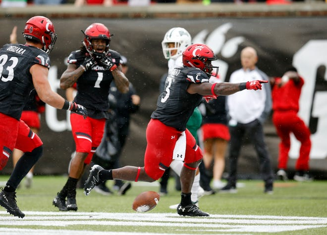Cincinnati Bearcats running back Michael Warren II (3) celebrates the go-ahead touchdown in the fourth quarter of the NCAA football game between the Cincinnati Bearcats and the Ohio Bobcats at Nippert Stadium on the University of Cincinnati campus in Cincinnati on Saturday, Sept. 22, 2018. The Bearcats overcame a 24-7 deficit at halftime to win 34-30, improving to 4-0 on the season.
