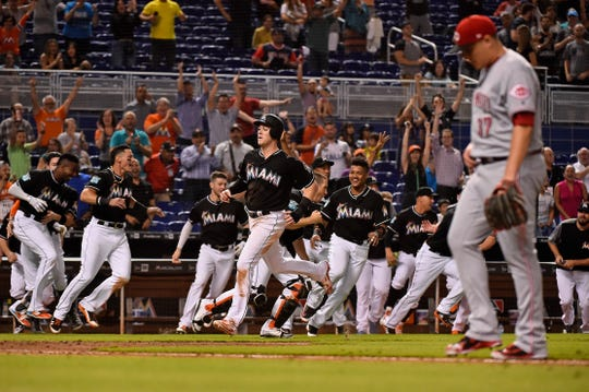 Sep 21, 2018; Miami, FL, USA; Miami Marlins third baseman Brian Anderson (15) scores the walk off run in the tenth inning to defeat the Cincinnati Reds at Marlins Park. Mandatory Credit: Jasen Vinlove-USA TODAY Sports