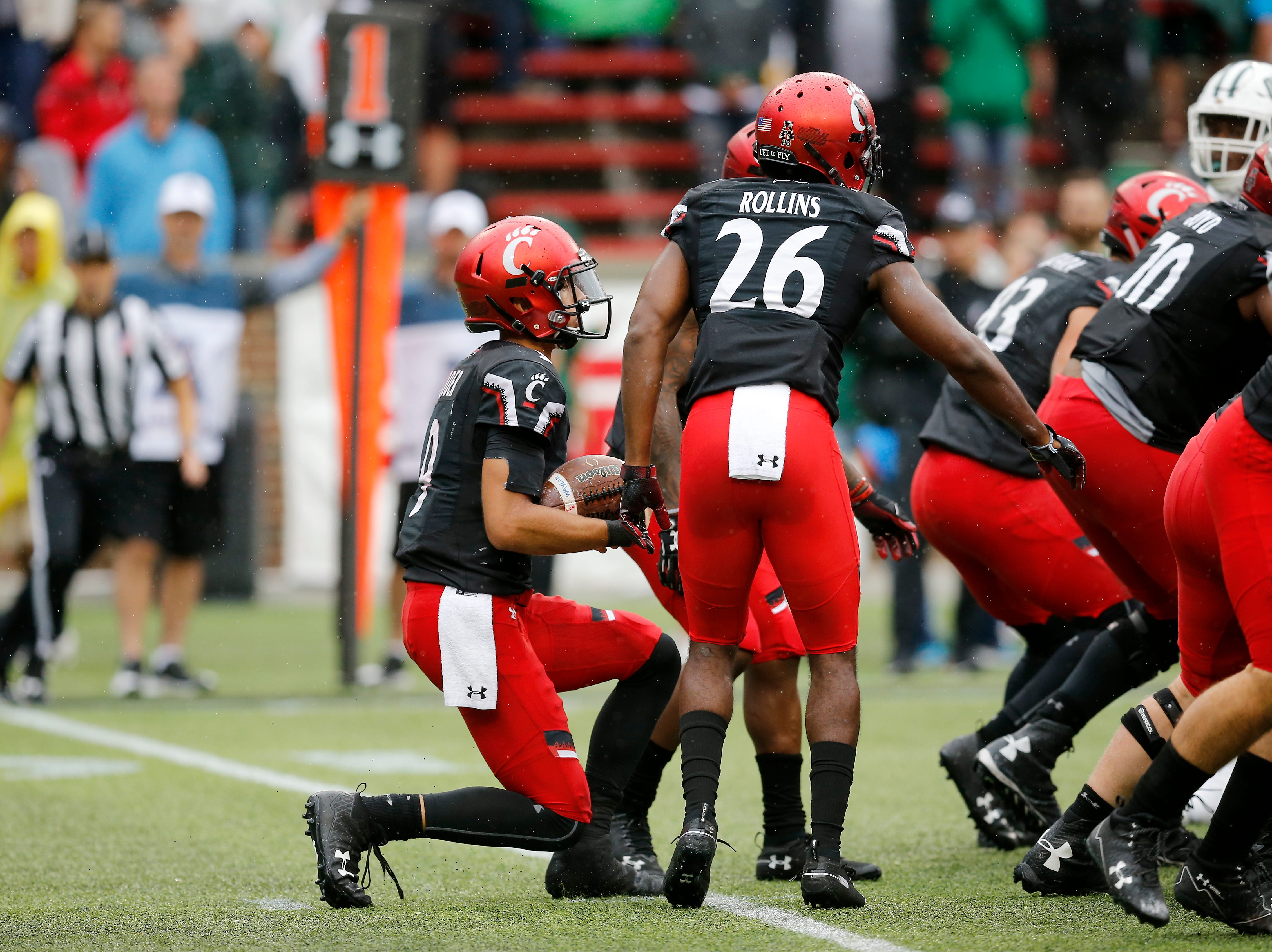 Cincinnati Bearcats quarterback Desmond Ridder (9) takes a knee in the victory formation to run out the clock in the fourth quarter of the NCAA football game between the Cincinnati Bearcats and the Ohio Bobcats at Nippert Stadium on the University of Cincinnati campus in Cincinnati on Saturday, Sept. 22, 2018. The Bearcats overcame a 24-7 deficit at halftime to win 34-30, improving to 4-0 on the season.