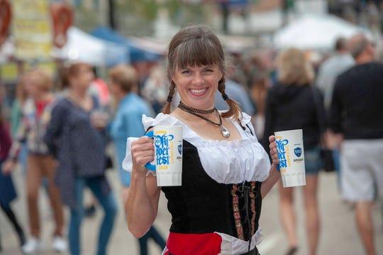 Oktoberfest Zinzinnati, Americas largest Oktoberfest takes over Second and Third Streets on Saturday, September 22, 2018. Kris Hilliard of Milford dressed in a tradition German Dirndl.