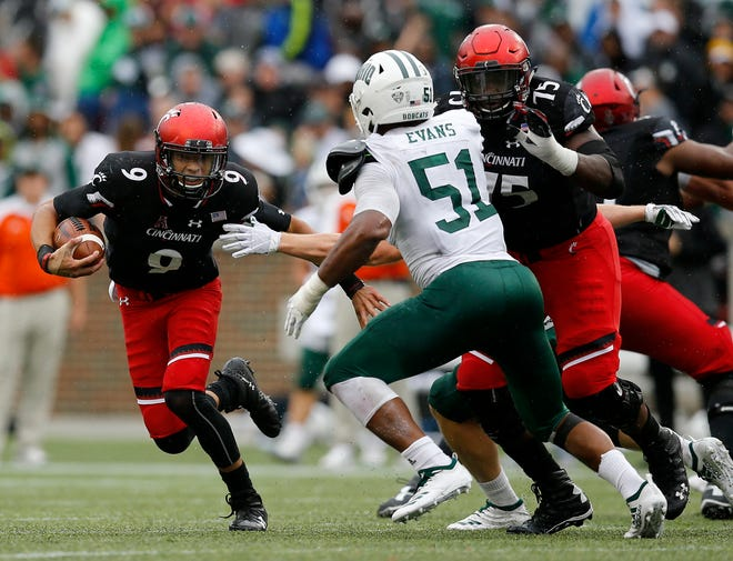 Cincinnati Bearcats quarterback Desmond Ridder (9) scrambles around the end on a carry in the fourth quarter of the NCAA football game between the Cincinnati Bearcats and the Ohio Bobcats at Nippert Stadium on the University of Cincinnati campus in Cincinnati on Saturday, Sept. 22, 2018. The Bearcats overcame a 24-7 deficit at halftime to win 34-30, improving to 4-0 on the season.