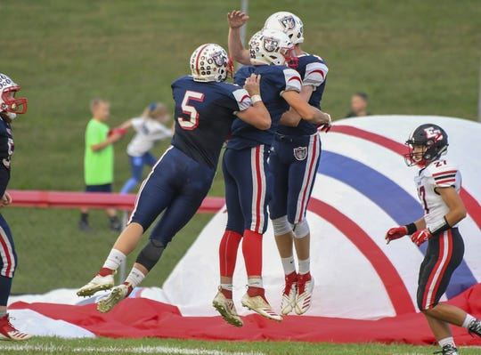 South Dearborn players celebrate after a touchdown against East Central, South Dearborn High School, Aurora, Indiana, Friday September 21, 2018