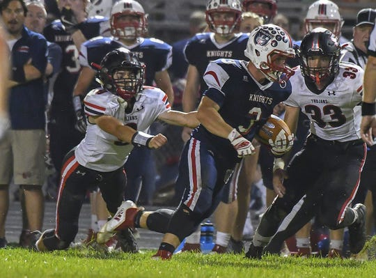 Knights' receiver Ethan Getz (3) runs away from the East Central defense, South Dearborn High School, Aurora, Indiana, Friday September 21, 2018