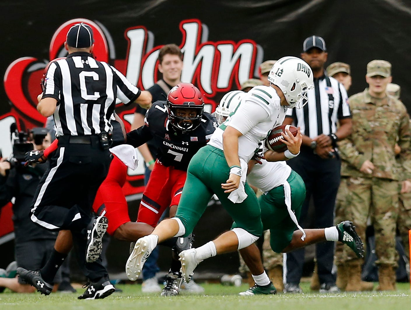 Ohio Bobcats quarterback Nathan Rourke (12) runs in a touchdown in the second quarter of the NCAA football game between the Cincinnati Bearcats and the Ohio Bobcats at Nippert Stadium on the University of Cincinnati campus in Cincinnati on Saturday, Sept. 22, 2018. The Bobcats led 24-7 at halftime.