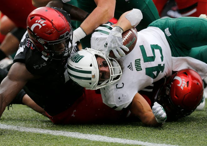 Ohio Bobcats running back A.J. Ouellette (45) stretches but is stopped short of the goal line on a carry in the fourth quarter of the NCAA football game between the Cincinnati Bearcats and the Ohio Bobcats at Nippert Stadium on the University of Cincinnati campus in Cincinnati on Saturday, Sept. 22, 2018. The Bearcats overcame a 24-7 deficit at halftime to win 34-30, improving to 4-0 on the season.