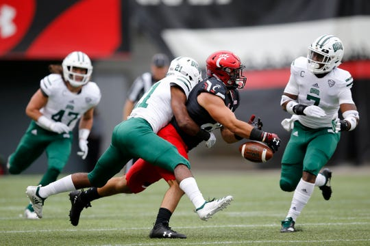 Ohio Bobcats cornerback Jalen Fox (21) breaks up a pass intended for Cincinnati Bearcats tight end Josiah Deguara (83) in the first quarter of the NCAA football game between the Cincinnati Bearcats and the Ohio Bobcats at Nippert Stadium on the University of Cincinnati campus in Cincinnati on Saturday, Sept. 22, 2018. The Bobcats led 24-7 at halftime.