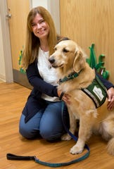 Dr. Mary Greiner is the medical director of CHECK, Foster Care Center at Cincinnati Children's Hospital Medical Center. Her staff sees every child that comes into the Hamilton County Children's Services care. Idina, a golden retriever, is a service dog that helps calm the children.