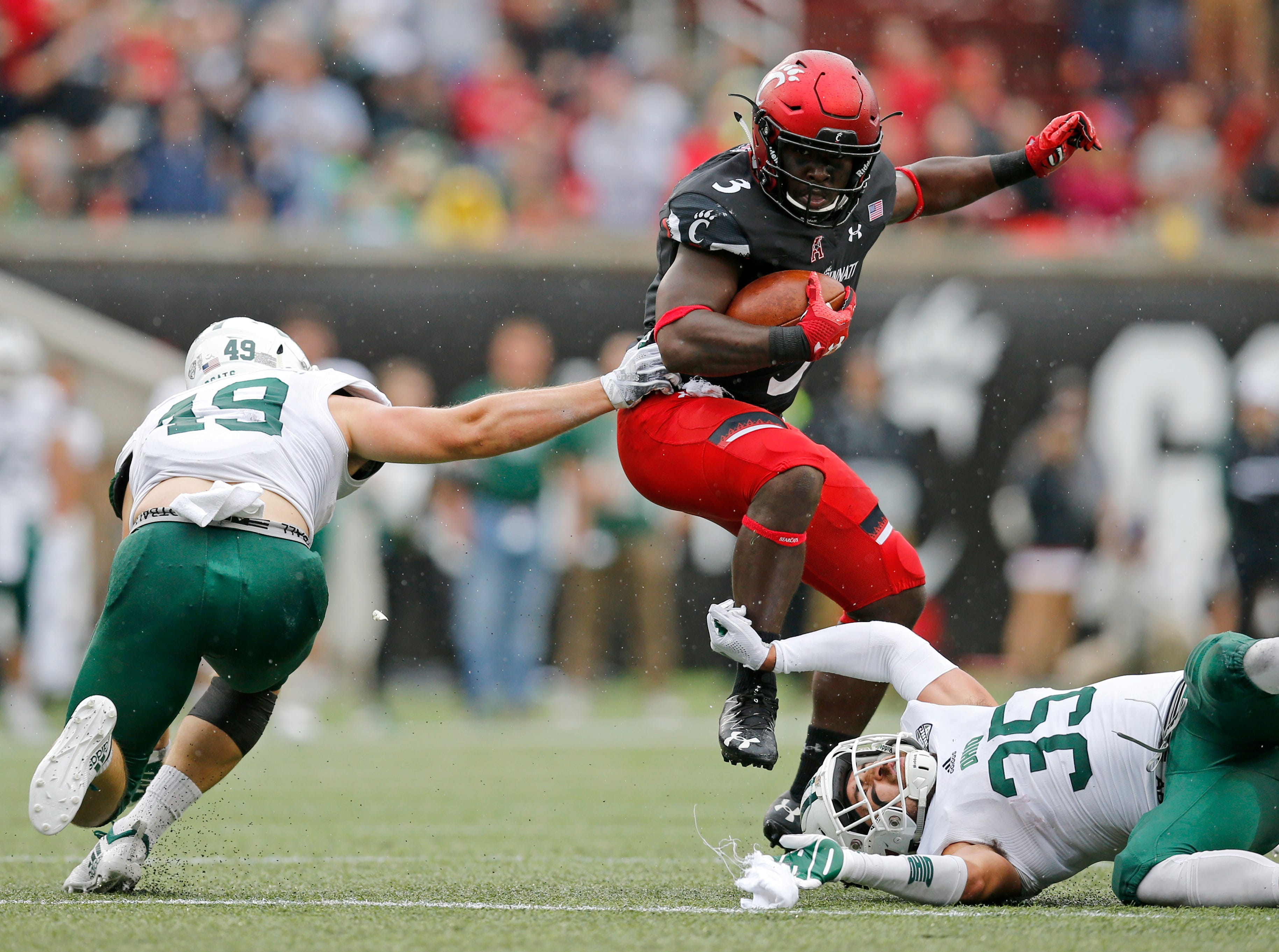 Cincinnati Bearcats running back Michael Warren II (3) evades tackles on a carry in the third quarter of the NCAA football game between the Cincinnati Bearcats and the Ohio Bobcats at Nippert Stadium on the University of Cincinnati campus in Cincinnati on Saturday, Sept. 22, 2018. The Bearcats overcame a 24-7 deficit at halftime to win 34-30, improving to 4-0 on the season.