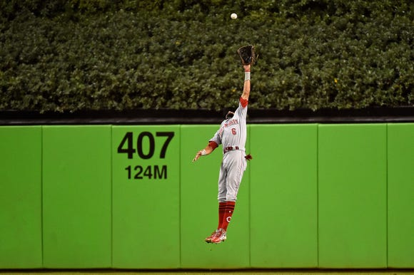 Sep 21, 2018; Miami, FL, USA; Cincinnati Reds center fielder Billy Hamilton (6) misplays the fly ball of Miami Marlins left fielder Derek Dietrich (32) during the second inning at Marlins Park. Mandatory Credit: Jasen Vinlove-USA TODAY Sports