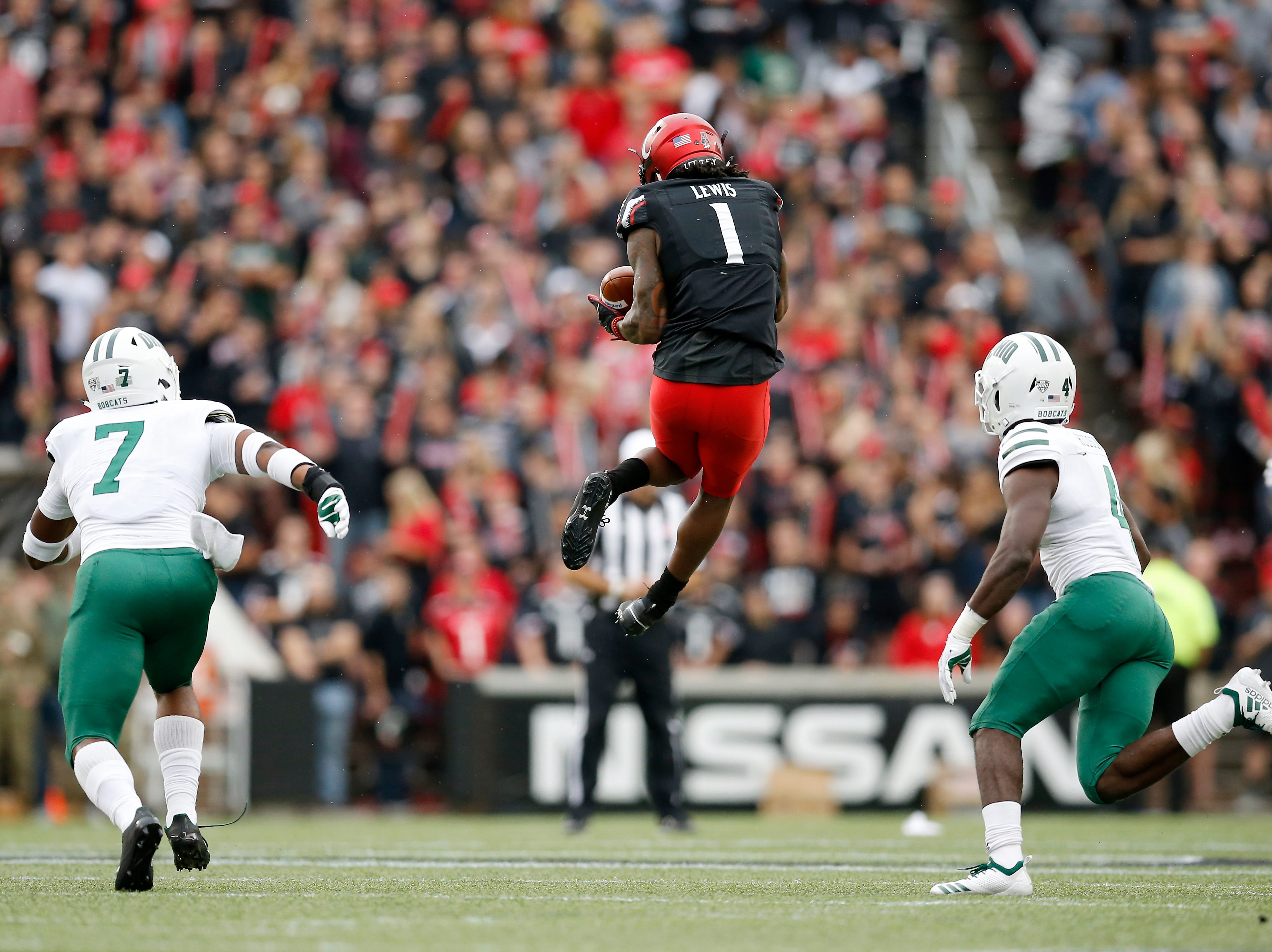 Cincinnati Bearcats wide receiver Alec Pierce (12) makes a leaping catch in the second quarter of the NCAA football game between the Cincinnati Bearcats and the Ohio Bobcats at Nippert Stadium on the University of Cincinnati campus in Cincinnati on Saturday, Sept. 22, 2018. The Bobcats led 24-7 at halftime.