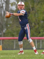 Knights quarterback Adam Dixon throws a pass in the first quarter against East Central, South Dearborn High School, Aurora, Indiana, Friday September 21, 2018