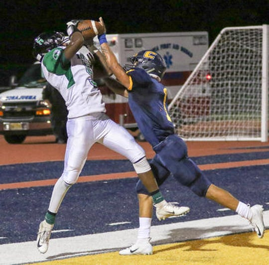 Colonia's Justice Harris (right) breaks up a pass to South Plainfield's Juan Cardona in the end zone on Friday, Sept. 21 at Colonia.