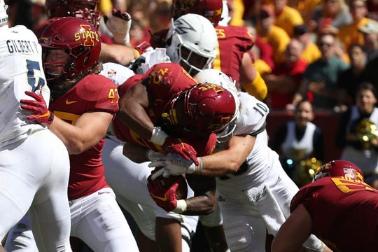 Sep 22, 2018; Ames, IA, USA; Iowa State Cyclones running back David Montgomery (32) breaks the line of scrimmage for a Cyclone touchdown against the Akron Zips at Jack Trice Stadium.