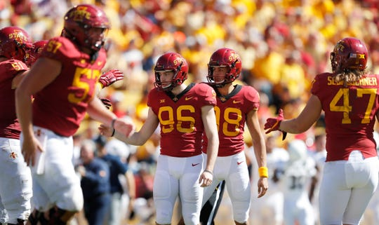 Iowa State place kicker Connor Assalley (96) celebrates with teammates after kicking 33-yard field goal during the second half of an NCAA college football game against Akron, Saturday, Sept. 22, 2018, in Ames, Iowa. Iowa State won 26-13.