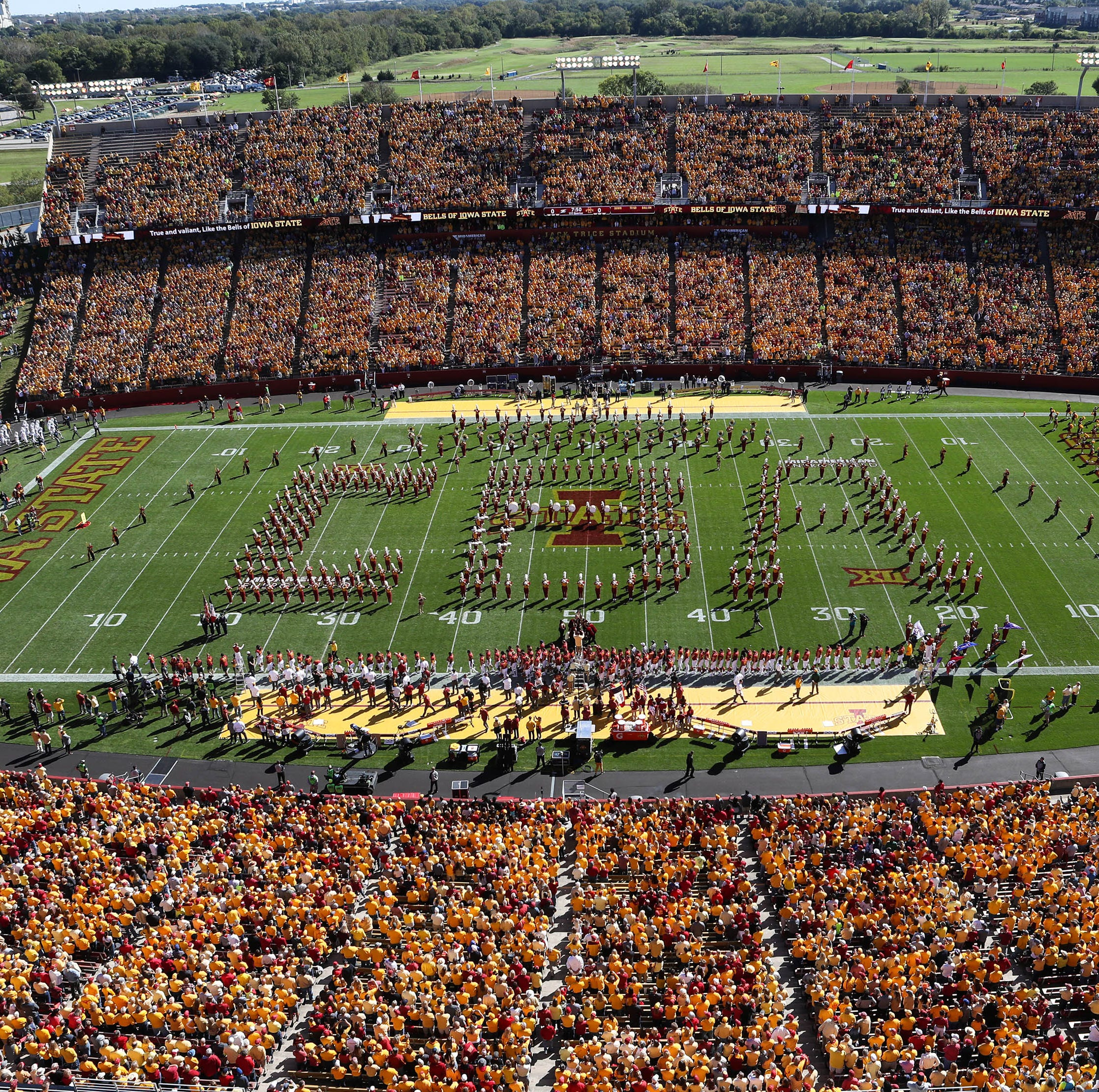 'We're one big family': Clad in yellow, Iowa State fans show support for slain student