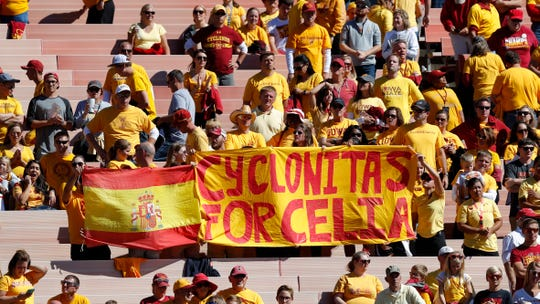 Iowa State fans hold a sign honoring slain student Celia Barquin Arozamena during the second half of an NCAA college football game between Iowa State and Akron, Saturday, Sept. 22, 2018, in Ames, Iowa. Barquin, who was the 2018 Big 12 women's golf champion and Iowa State Female Athlete of the Year, was found Monday morning in a pond at a golf course near the Iowa State campus.